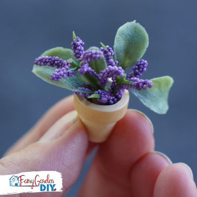 tiny pot of flowers for a fairy garden