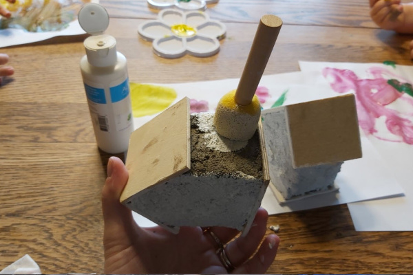 painting the concrete fairy garden houses