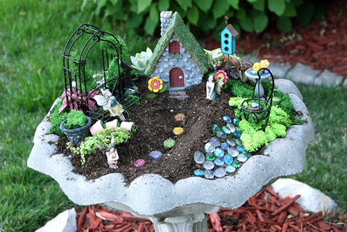 outdoor fairy garden in a birth bath