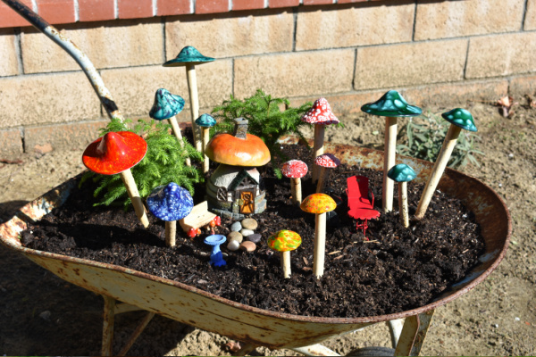 outdoor fairy garden container idea: wheelbarrow