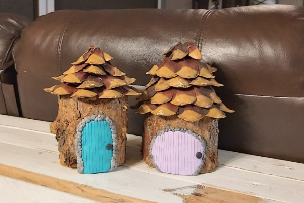 fairy garden house with pinecone roof