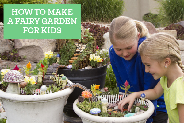 kids looking at a fairy garden