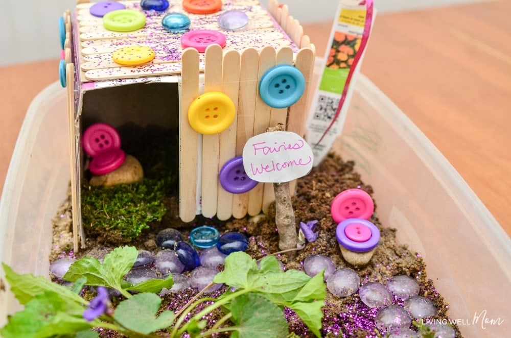 Fairy house made from crafts sticks + glitter!