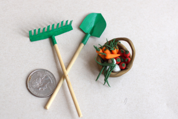 hand made mini garden tools and polymer clay vegetables with a quarter for perspective