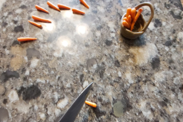 making DIY miniature carrots from polymer clay