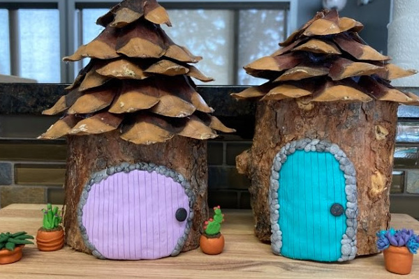 simple fairy house from log and pinecone