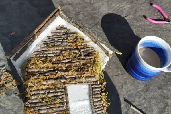 how to make a DIY fairy house out of twigs