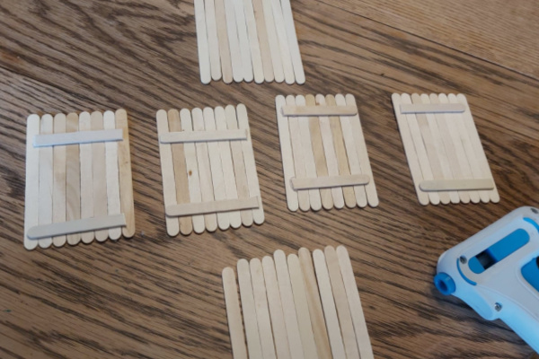 the walls of the popsicle stick fairy house