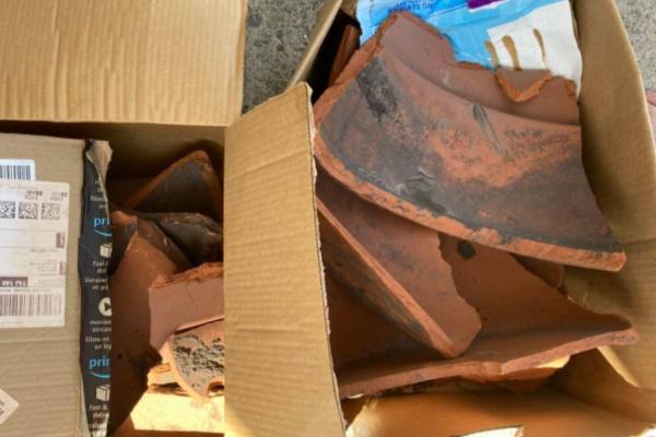 box of broken terracotta pots