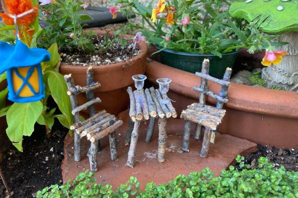 twig fairy furniture in broken pot garden