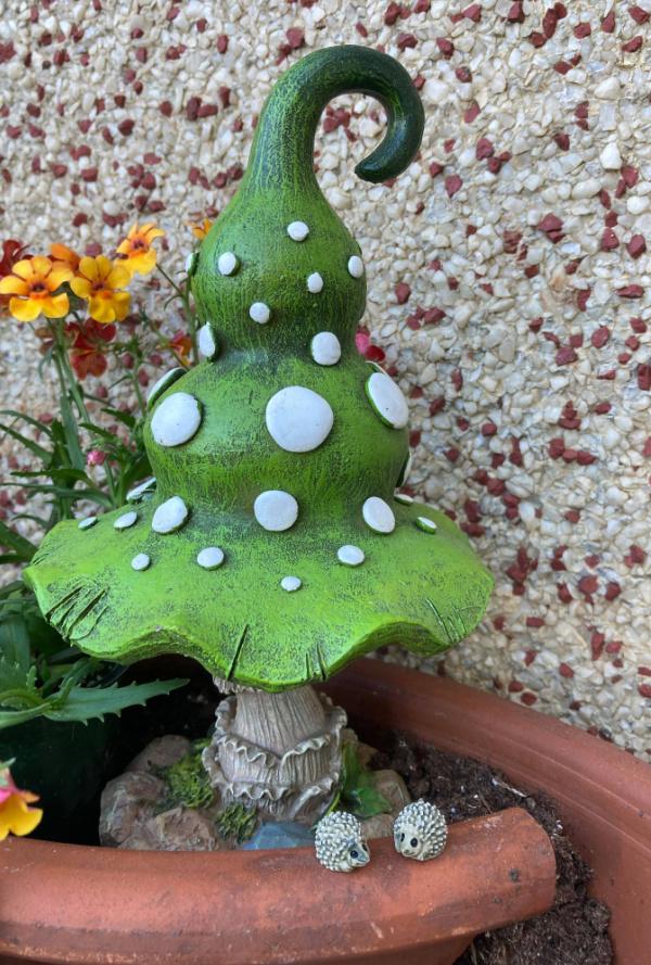 miniature hedgehogs and decorative mushroom