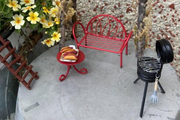 DIY mini BBQ and hot dogs by red bench